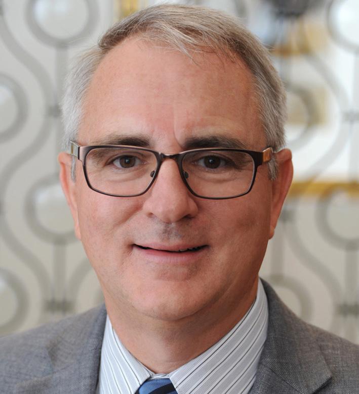 Headshot photo of Tim Johnson, smiling